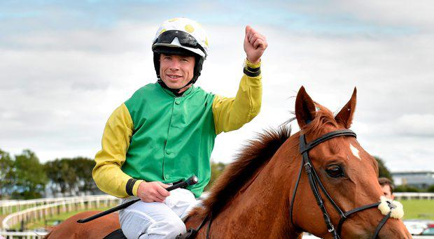 30 July 2015; Denis O'Regan celebrates on Quick Jack after winning the Guinness Galway Hurdle Handicap. Galway Racing Festival, Ballybrit, Galway. Picture credit: Cody Glenn / SPORTSFILE