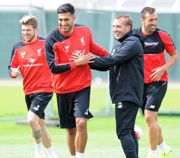 Emre Can and Brendan Rodgers during Liverpool training