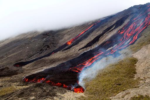 Lava flows out of the Piton de la Fournaise volcano as it erupts on the French island of Réunion Credit: Richard Bouhet/AFP/Getty Images