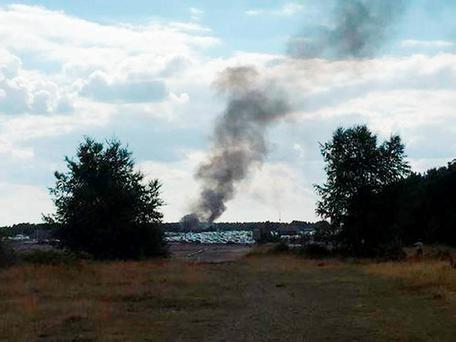 Taken with permission from the Twitter feed@NathanGFilm of smoke rising from Blackbushe airport after a light aircraft crashed into a car auction shortly after take-off. Nathan Greenwood/PA Wire