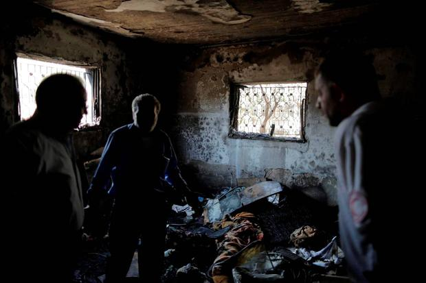 Palestinians inspect a house which was set on fire in a suspected attack by Jewish extremists in Duma village near the West Bank city of Nablus July 31, 2015. Suspected Jewish attackers torched a Palest REUTERS/Ammar Awad