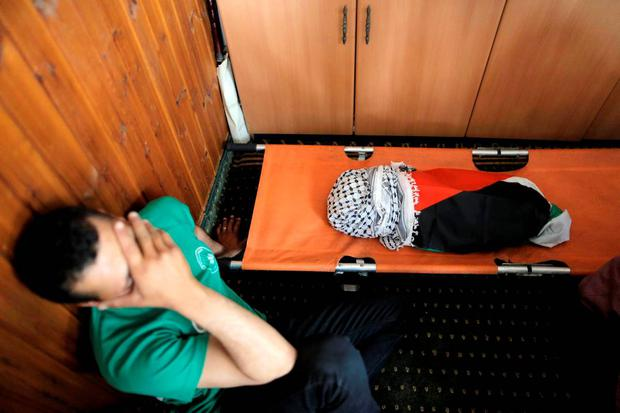 A mourner reacts next to the body of 18-month-old Palestinian baby Ali Dawabsheh, who was killed after his family's house was set to fire in a suspected attack by Jewish extremists in Duma village near the West Bank city of Nablus July 31, 2015. REUTERS/Ammar Awad