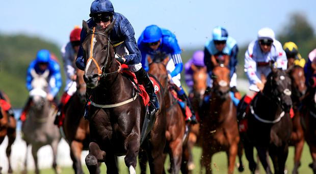 So Beloved ridden by jockey Daniel Tudhope on the way to winning the Betfred Mile during day four of the Glorious Goodwood Festival, Chichester.