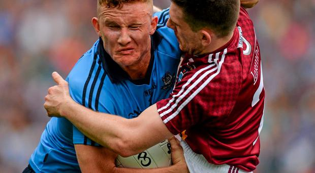 Dublin forward Ciaran Kilkenny attempts to hold off the challenge of James Dolan of Westmeath during last month's Leinster final