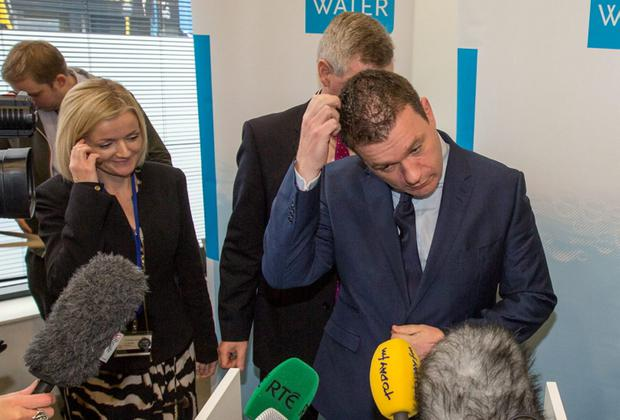 Environment Minister Alan Kelly with Irish Water chief John Tierney at a media briefing. 'While not as electorally damaging for Fine Gael, the whole thing has been disastrous for the Labour Party, ' Photo: Mark Condren