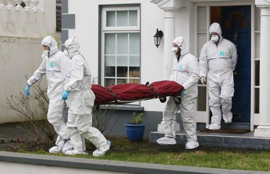 Members of the gardai remove the body of Tom O'Gorman from his home on Beechpark Avenue Castleknock, Dublin