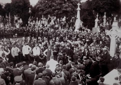 Patrick Pearse delivers the oration over the grave of Jeremiah O'Donovan Rossa on August 1 1915. Major General John MacBride (standing behind Pearse) and Thomas J Clarke (far right of picture) would also be shot for their part in the Easter Rising the following year.