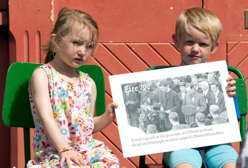 Cara and Oran Waters, Rosscarbery, vCo Cork, with a picture of a new stamp to mark the centenary of the oration.