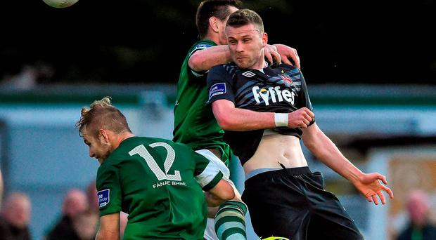 31 July 2015; Ciaran Kilduff, Dundalk, scores his side's first goal against Bray Wanderers past defenders Niall Cooney, 12, and Alan McNally. SSE Airtricity League Premier Division, Bray Wanderers v Dundalk. Carlisle Grounds, Bray, Co. Wicklow. Picture credit: Matt Browne / SPORTSFILE