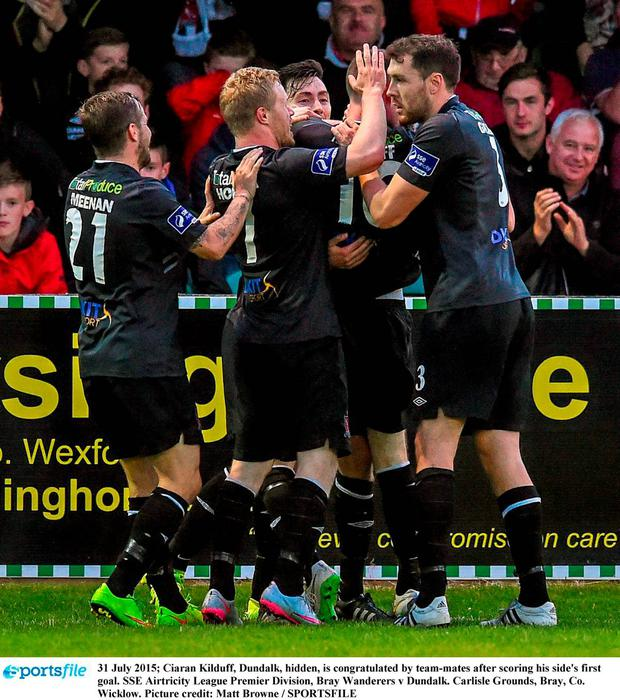 31 July 2015; Ciaran Kilduff, Dundalk, hidden, is congratulated by team-mates after scoring his side's first goal. SSE Airtricity League Premier Division, Bray Wanderers v Dundalk. Carlisle Grounds, Bray, Co. Wicklow. Picture credit: Matt Browne / SPORTSFILE