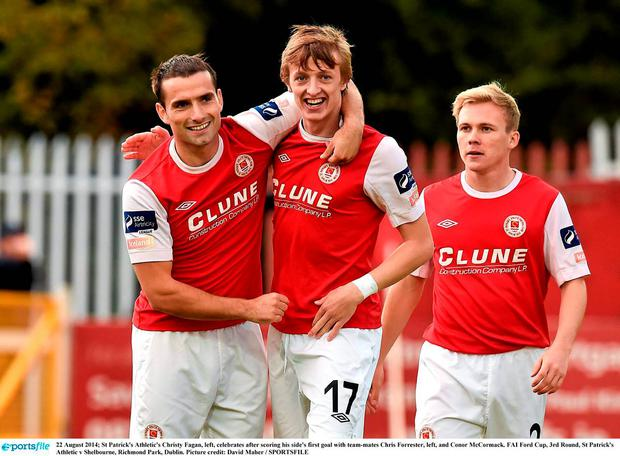 St Patrick's Athletic's Christy Fagan, left, with team-mates Chris Forrester, left, and Conor McCormack. David Maher / SPORTSFILE