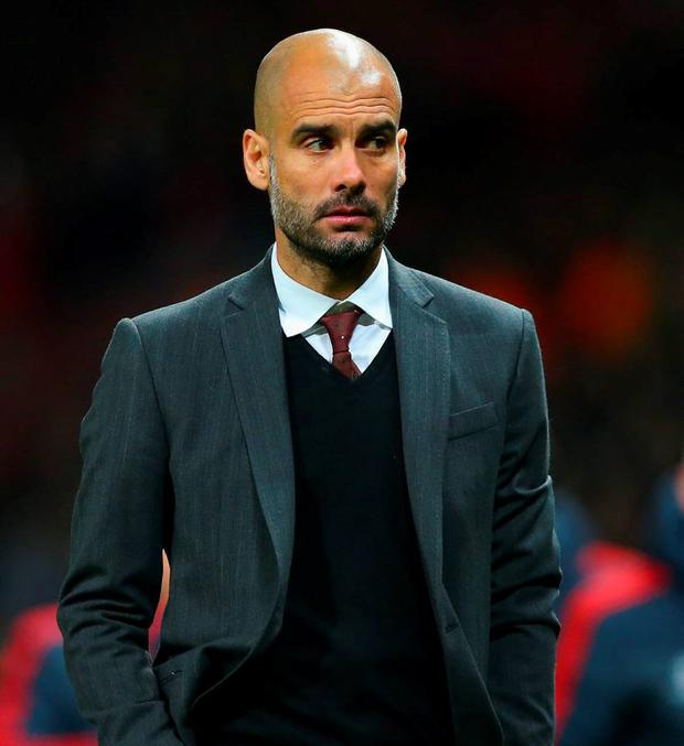 Pep Guardiola, head coach of Bayern Muenchen, plays down talk of him leaving the club