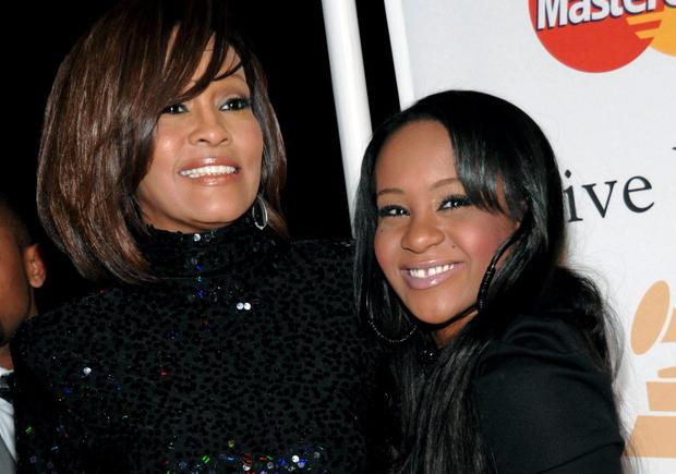 Singer Whitney Houston, left, and daughter Bobbi Kristina Brown arrive at an event in Beverly Hills, Calif. (AP Photo/Dan Steinberg, File)