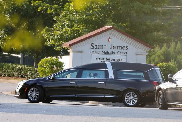 A hearse arrives at St. James United Methodist Church before funeral services for Bobbi Kristina Brown Saturday, Aug. 1, 2015, in Alpharetta, Ga. (AP Photo/John Bazemore)