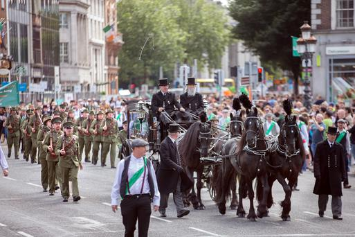 A horse drawn hearse leads historical groups in period uniforms from all over Ireland across O'Connell Bridge during the Reenactment of the O'Donovan Rossa funeral. Photo: Tony Gavin