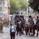 A horse drawn hearse leads historical groups in period uniforms from all over Ireland across O'Connell Bridgeduring the Reenactment of the O'Donovan Rossa funeral. Photo: Tony Gavin