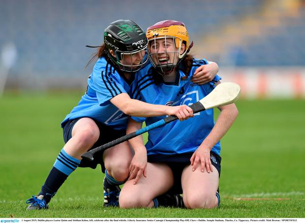 1 August 2015; Dublin players Laoise Quinn and Siobhan Kehoe, left, celebrate after the final whistle. Liberty Insurance Senior Camogie Championship Play-Off, Clare v Dublin. Semple Stadium, Thurles, Co. Tipperary. Picture credit: Matt Browne / SPORTSFILE