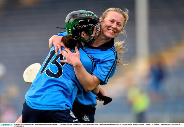 Dublin players Aine Fanning and Siobhan Kehoe,15, celebrate after the final whistle