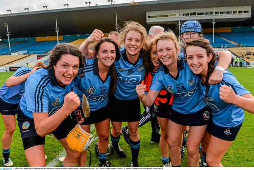 1 August 2015; Dublin players celebrate after the final whistle. Liberty Insurance Senior Camogie Championship Play-Off, Clare v Dublin. Semple Stadium, Thurles, Co. Tipperary. Picture credit: Matt Browne / SPORTSFILE