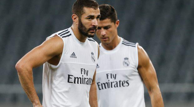 Cristiano Ronaldo and Karim Benzema of Real Madrid take part in a training session