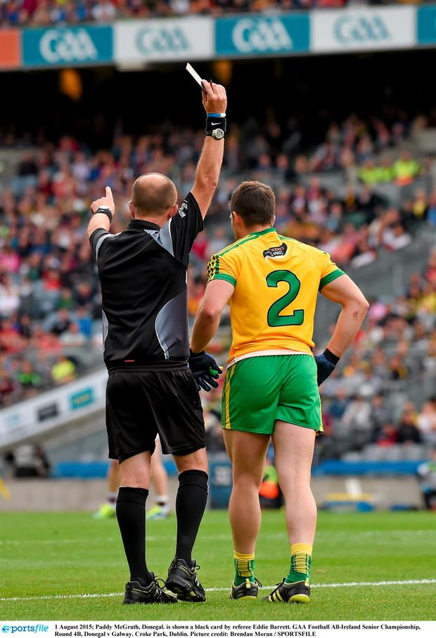 Paddy McGrath, Donegal. is shown a black card by referee Eddie Barrett