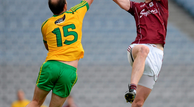 Colm McFadden, Donegal, steals the ball away from Thomas Flynn, Galway