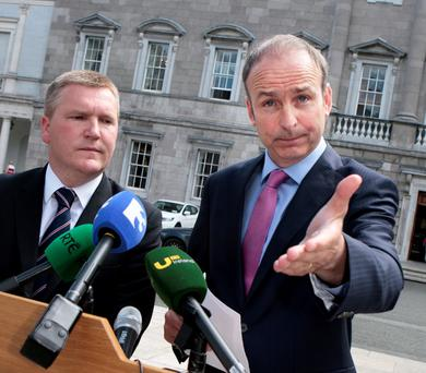 WINNERS AND LOSERS: Fianna Fail leader Micheal Martin with Michael McGrath, the party's finance spokesperson