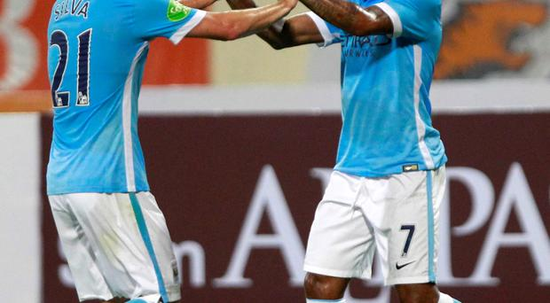 David Silva celebrates with Raheem Sterling after scoring against Vietnam's national team last week