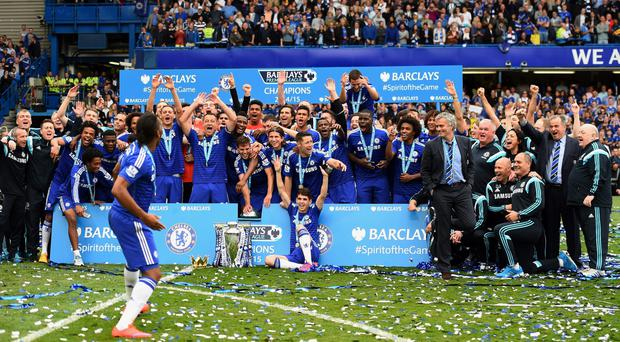 Didier Drogba is the cheerleader as Chelsea players and staff celebrate winning last season's Premier League title