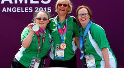 From left, is Nuala Browne from Strabane, Co Tyrone, who won silver in the 500m kayaking competition, with team mates Rita Quirke, who won a bronze, and Nicola Higgins, who was presented with a 5th place ribbon