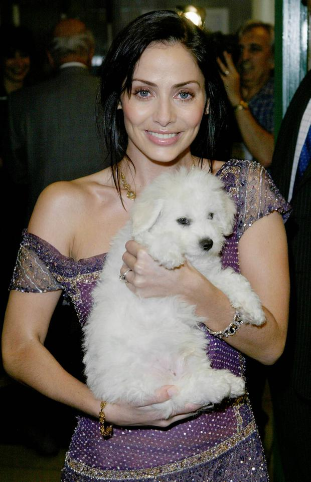 Singer Natalie Imbruglia holds a dog during the opening of this years July sale at Harrods Knightsbridge on June 30, 2003 in London, England. (Photo By Steve Finn/Getty Images)