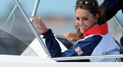 Catherine, Duchess of Cambridge waves to a british competitor during the Women's Laser Radials race on Day 10 of the London 2012 Olympic Games at the Weymouth & Portland Venue at Weymouth Harbour on August 6, 2012 in Weymouth, England. (Photo by Pascal Le Segretain/Getty Images)