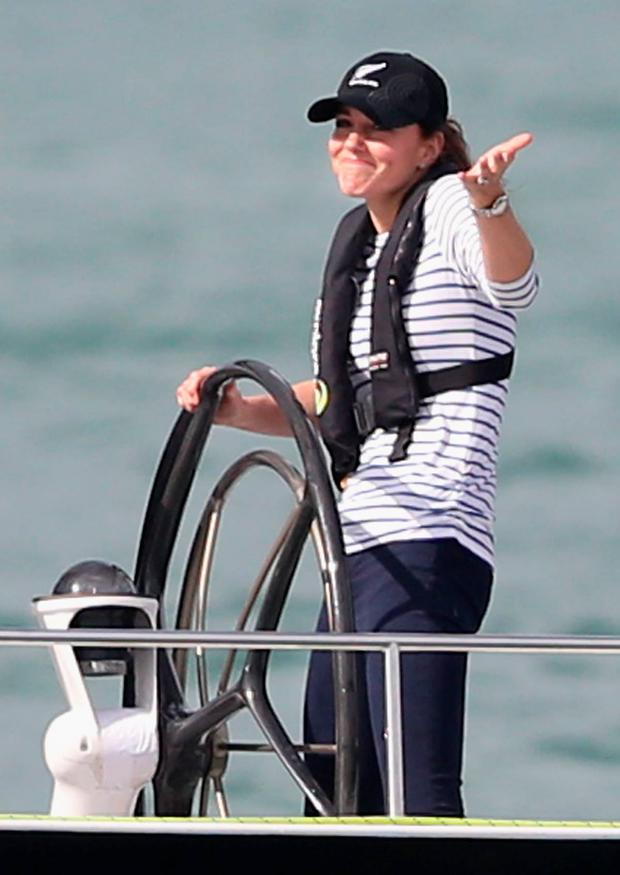 Catherine, Duchess of Cambridge gestures to Prince William, Duke of Cambridge as she helms an America's Cup yacht as she races Prince William, Duke of Cambridge in Auckland Harbour on April 11, 2014 in Auckland, New Zealand. The Duke and Duchess of Cambridge are on a three-week tour of Australia and New Zealand, the first official trip overseas with their son, Prince George of Cambridge. (Photo by Chris Jackson/Getty Images)