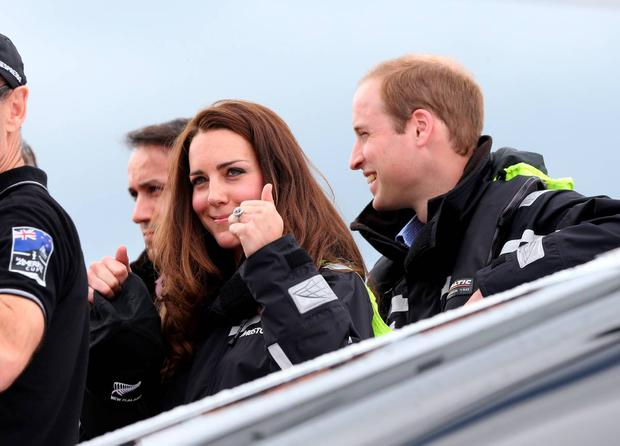 Britain's Prince William (R) and his wife Catherine (C) prepare to sail on Team New Zealand's America's Cup yachts on Auckland Harbour on April 11, 2014. Britain's Prince William, his wife Kate and their son Prince George are on a three-week tour of New Zealand and Australia. AFP PHOTO/POOL/FIONA GOODALL (Photo credit should read Fiona GOODALL/AFP/Getty Images)