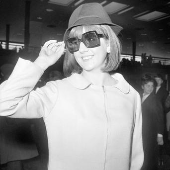 File photo dated 31/3/1965 of Cilla Black at London Airport where she was leaving for New York to appear on the Ed Sullivan Show. Photo: PA Wire