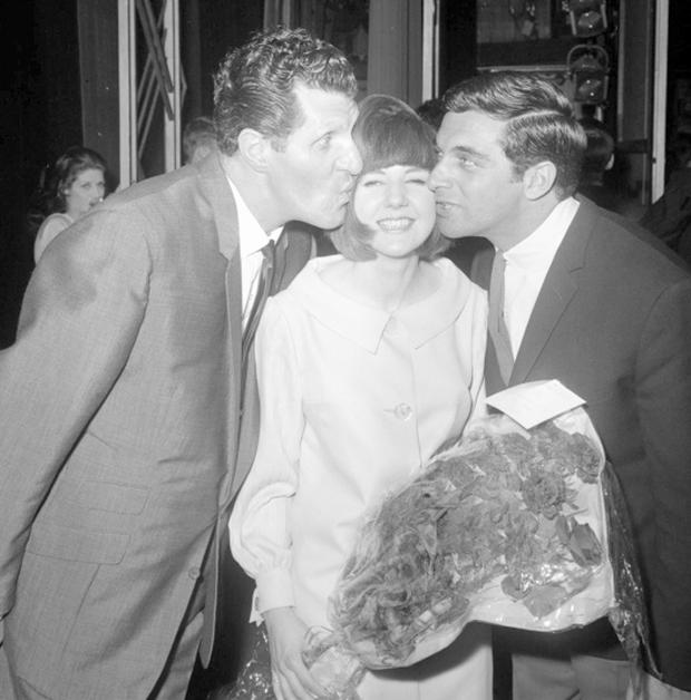 File photo dated 28/5/1964 of Tommy Cooper and Frankie Vaughn helping Cilla Black to celebrate her birthday. Photo: PA Wire