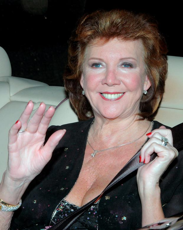 Cilla Black arrives for the party to celebrate the civil ceremony of British pop star Elton John and David Furnish in Windsor, southern England in this December 21, 2005 file photo. Reuters/Toby Melville/Files
