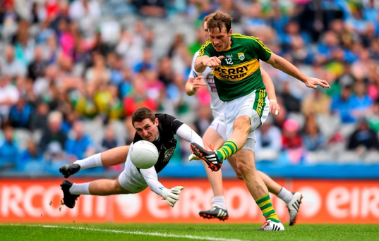 Kerry's Donnchadh Walsh shoots past Mark Donnellan of Kildare, from which he scored from the rebound.