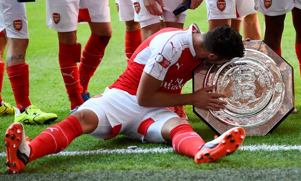Arsenal's Alexis Sanchez celebrates with the trophy after winning the FA Community Shield