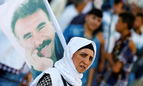 A demonstrator holds a portrait of Kurdistan Workers Party (PKK)'s jailed leader Abdullah Ocalan during a march in solidarity with him in Diyarbakir, Turkey, August 1, 2015. REUTERS/Umit Bektas