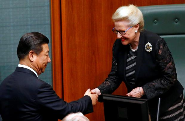 Speaker of the House of Representatives Bronwyn Bishop shakes hands with China's President Xi Jinping after he spoke in the House of Representatives at Parliament House in Canberra in this picture taken November 17, 2014. REUTERS/David Gray