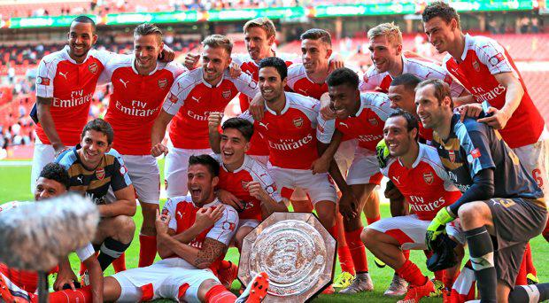Arsenal celebrate after their FA Community Shield victory over Chelsea during the FA Community Shield at Wembley Stadium, London. PRESS ASSOCIATION Photo. Picture date: Sunday August 2, 2015. See PA story SOCCER Shield. Photo credit should read: Nigel French/PA Wire. EDITORIAL USE ONLY. No use with unauthorised audio, video, data, fixture lists, club/league logos or