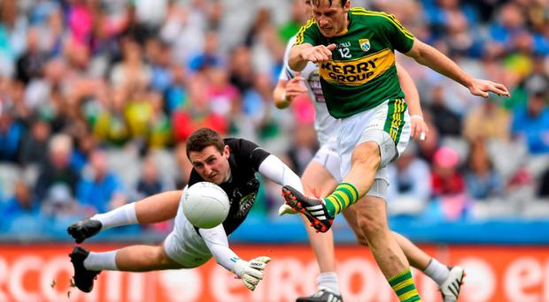 Kerry's Donnchadh Walsh shoots past Mark Donnellan before scoring from the rebound