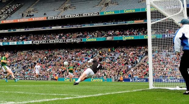 Colm Cooper scores his side's fifth goal during Kerry's destruction of Kildare