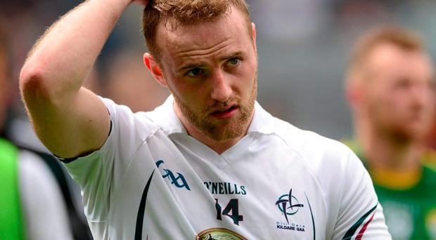 Kildare's Alan Smith leaves the field after this team's heavy defeat against Kerry in Croke Park
