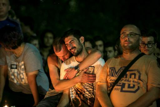People react during a candlelight vigil in Tel Aviv, Israel, for Shira Banki, who died on Sunday of stab wounds sustained when an ultra-Orthodox man with a knife attacked a Gay Pride parade in Jerusalem three days ago, August 2, 2015. REUTERS/Baz Ratner