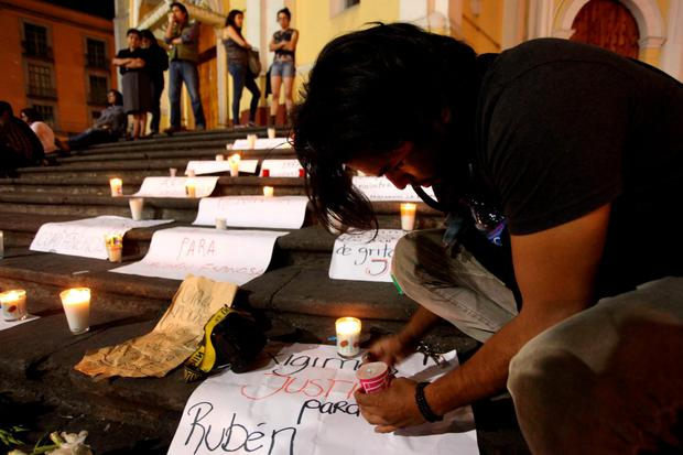 Journalists hold a late night vigil to protest against the latest murder of a fellow journalist in Veracruz, Mexico, Saturday Aug. 1, 2015. (AP Photo/Felix Marquez)