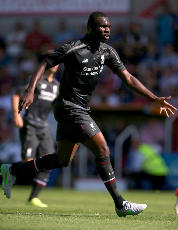 Christian Benteke celebrates after scoring for Liverpool in their 2-1 win at Swindon