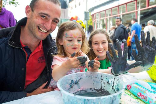 Damien and Ellie Mae Alyward with Triona Dooley Cullinane of the WIT School of Science at the Spraoi festival in Waterford