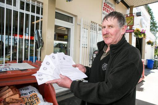 Garage owner Michael Clohessy with some of the garda victim letters sent to him after the various robberies at his premises. Photos: Kyran O'Brien